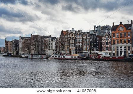 Amsterdam - February 7: a look at the canal houses along the Amstel River in Amsterdam city center on February 7, 2016 in Amsterdam.