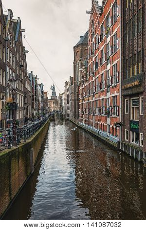 Amsterdam  - February 7: View on the canal Oudezijds Kolk in the center of Amsterdam, taken February 7, 2016 in Amsterdam.