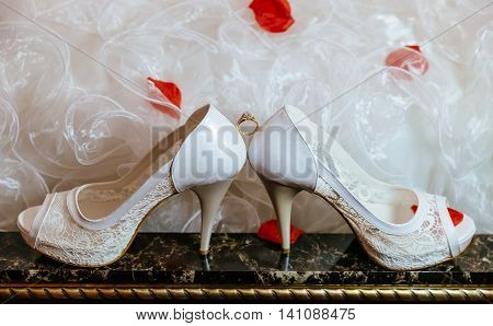 group object of wedding jewellery accessory, church rings, necklace and shoes ring wedding shoes