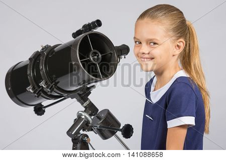 The Young Astronomer At The Telescope Is Smiling And Looking To The Frame