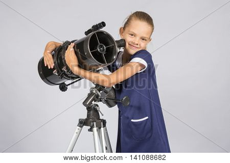 Seven-year Girl Hugging Her Given Reflector Telescope