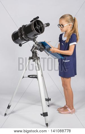 The Young Astronomer With Glasses Writes Observations