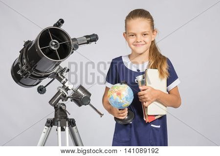 Girl Astronomer Is A Telescope With A Globe And Books In The Hands
