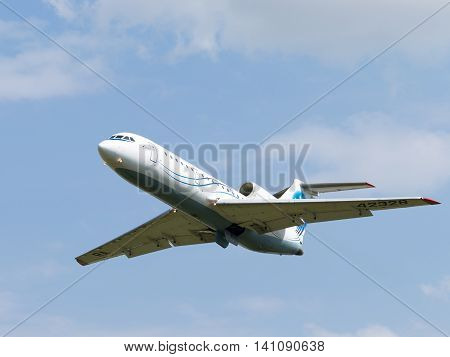 Moscow region - 31 July 2016: A passenger plane Yak-42D Saratov Airlines flies to Moscow's Domodedovo airport and the sky July 31 2016 Moscow Region Russia