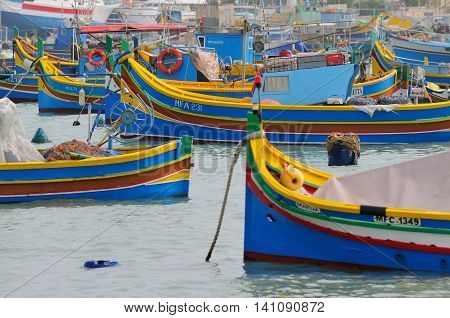 MARSAXLOKK, MALTA - APR 25 :The legendary and iconic Malta fishing boats in the Marsaxlokk village in Malta April 25, 2011