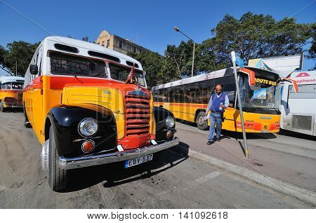 VALLETTA, MALTA - APR 19 :The legendary and iconic Malta public buses in the Valletta city bus station in Malta April 19, 2011