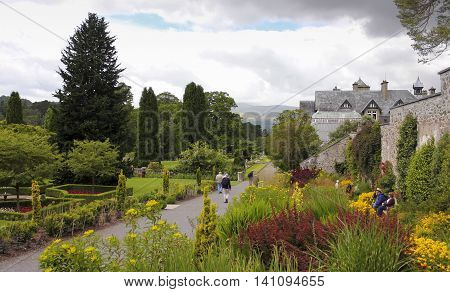 CONWY, WALES, JUNE 27. Bodnant Garden on June 27, 2016, near Conwy, Wales. Visitors to Bodnant Garden near Conwy Wales enjoy the area around the entrance to the Garden.