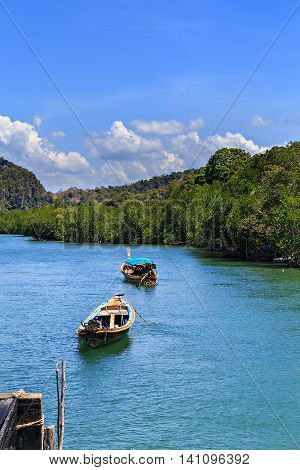 Boats In Tropical Mangrove Forest And Nice Sky
