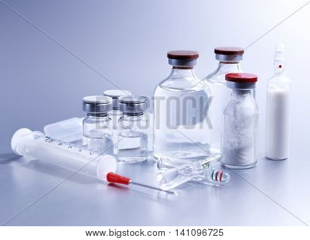 Vials and syringe, studio shot. Medical objects for vaccination. Vaccine drew up into a syringe.