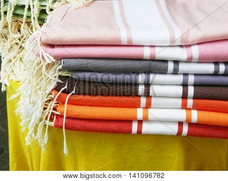 Closeup detail of stack of french colorful fabric souvenirs used as blanket or tablecloth