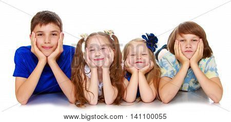 Horizontally elongated rectangular frame. Two little girls sisters and two brothers of a teenager lying on the floor with his head in his hands. The picture shows 4 children - Isolated on white background