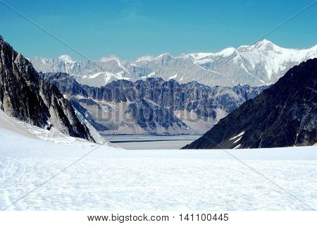 The view of a mountain range in Alsaka from a glacier
