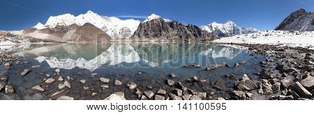 view of mount Cho Oyu mirroring in lake - Cho Oyu base camp - Everest trek - Nepal