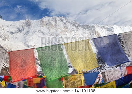 Buddhist prayer flags and Mount Annapurna from Annapurna base camp Nepal
