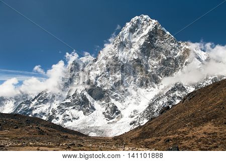 Mount Arakam Tse and clouds near Cho La Pass beautiful mount on the way to Everest base camp three passes trek Khumbu valley Sagarmatha national park Nepal