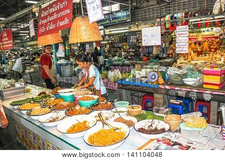 Chiang Mai, Thailand - July 23, 2011: People are selling food in the famous Sunday night market in town.