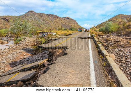 Nopolo, Baja, Baja California Sur, Mexico - August 25, 2013: Collapsed highway linking La Paz to Loreto during the tropical storm named Juliette.