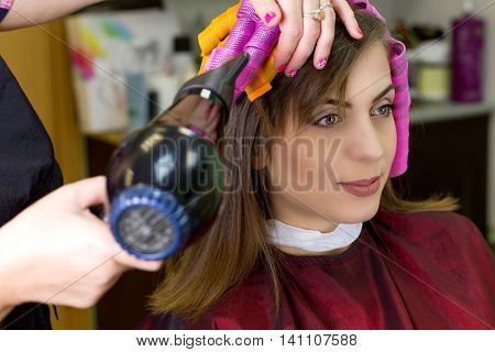 Young girl in hair doing shop. New hair style