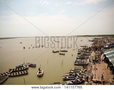 Boats And People On The Ghats The Banks Of Ganges River In Uttar Pradesh, India