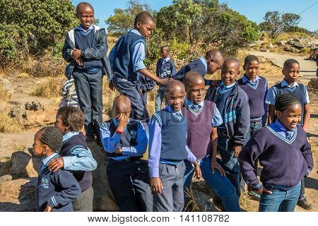 Blyde River Canyon Nature Reserve, South Africa - August 22, 2014: South African smiling kids posing in school uniform.