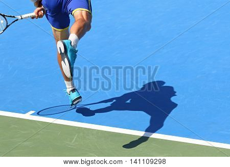 Tennis Player Serves The Ball