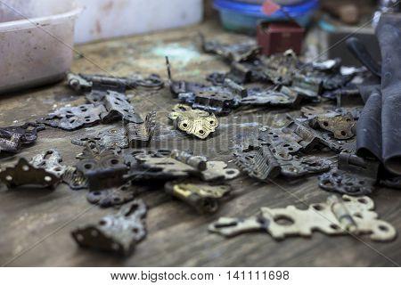 Bookbinder tarnishes century old hardware for custom book.