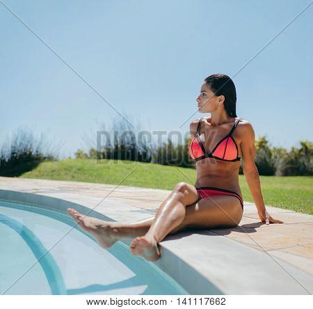 Sensual Female Model In Bikini Relaxing At Poolside