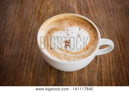 Cappuccino Coffee On Wooden Table