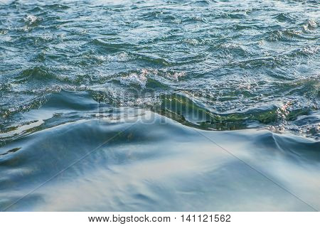 wavy surface of flowing water of river