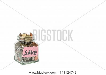 Glass jar of coin with save word isolated on white with copyspace. Photo with clipping path