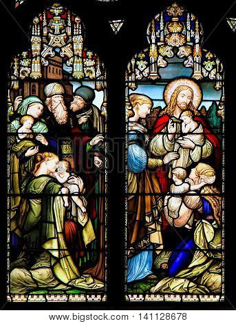 EDINBURGH, SCOTLAND - OCTOBER 02, 2014: Stained glass window illustrated Bible stories in the St Giles' Cathedral of Edinburgh Scotland UK.