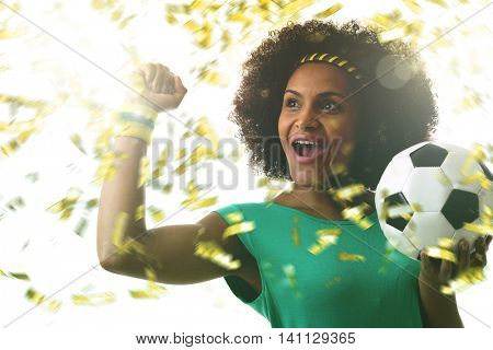 Latina young woman on green celebrating
