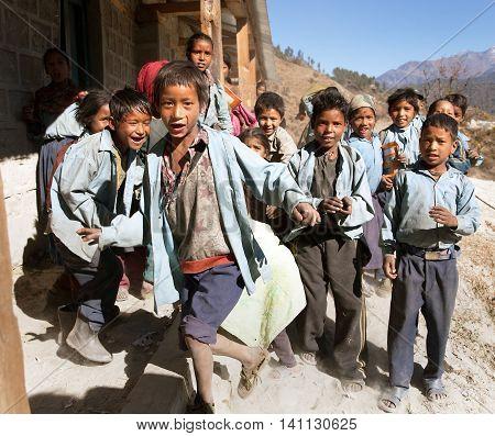 RARA NATIONAL PARK WESTERN NEPAL 27th NOVEMBER 2013 - group of nepalese school children near Rara lake in western Nepal in school uniform
