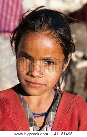 KOLTI VILLAGE WESTERN NEPAL 3rd DECEMBER 2013 - nepalese child head of young girl in western Nepal near Kolti village