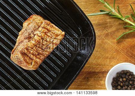 Roasted Pork Loin On A Wooden Table.