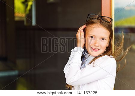 Close up portrait of a cute little girl of 7-8 years old, back to school concept