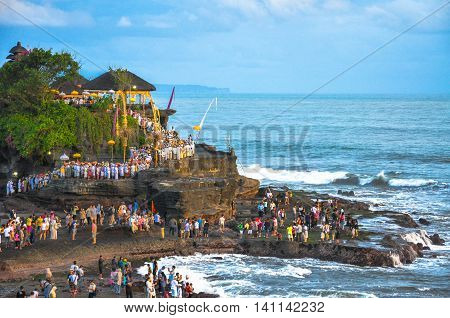 Tanah Lot,Bali,Indonesia-May,28,2010:Tourists visiting Pura Tanah Lot,Temple of Sea,Bali,Indonesia.Its the one of the most popular places of interest in Bali, is located on the coast of West Bali,Indonesia.