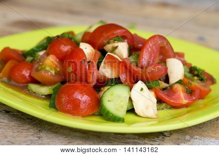 fresh caprese salad with bocconcini cheese and tomatoes