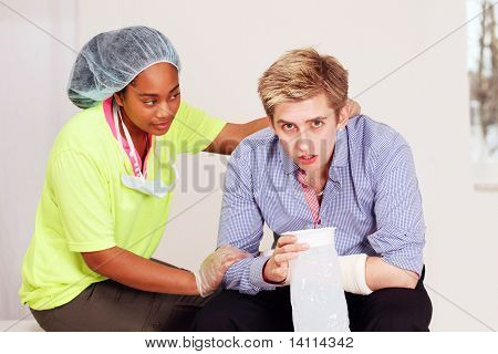 Medical worker with patient