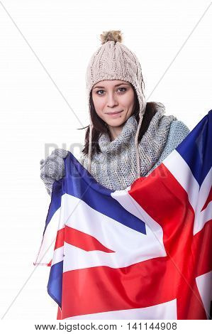 Portrait Of A Beautiful British Girl Smiling Holding Up The Uk Flag, Looking Away. Isolated On White