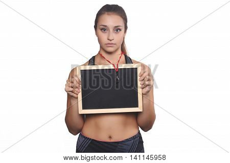 Portrait of an athlete young woman with whistle and chalkboard. Isolated white background.