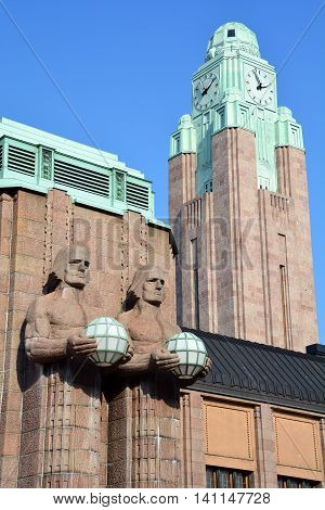 HELSINKI FINLAND SEPTEMBER 25 2015: Statues holding the spherical lamps at the Helsinki Central railway station is a widely recognised landmark in Kluuvi, part of central Helsinki