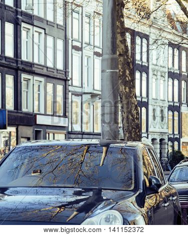 european parking, cars on background with Amsterdam facade sunny day