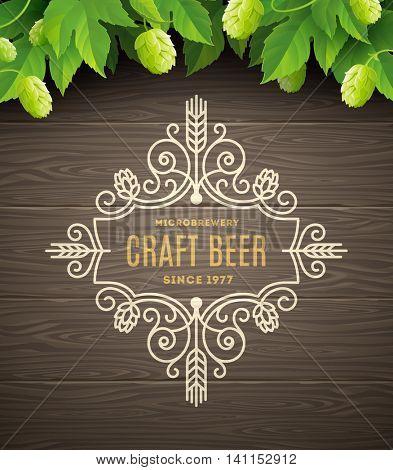 Green hops and flourishes beer emblem on a wooden plank background - vector illustration