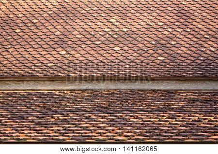 Tiles on the roof of the adjacent area.