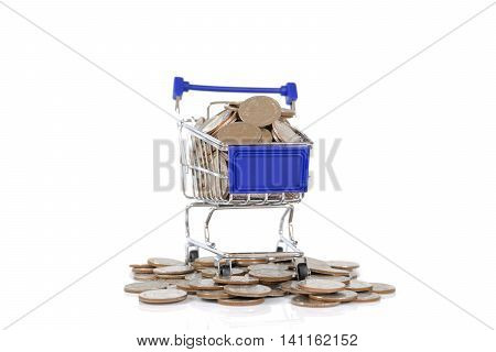 Mini shopping cart with coins on white background