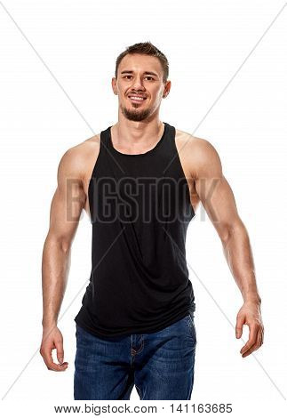 portrait of a gorgeous male model in sweatshirt without sleeves standing on white background