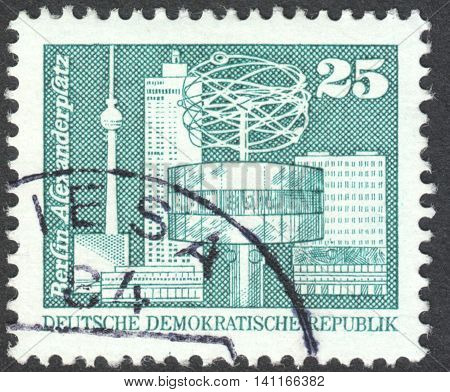 MOSCOW RUSSIA - CIRCA APRIL 2016: a post stamp printed in DDR shows Alexander's place Berlin the series