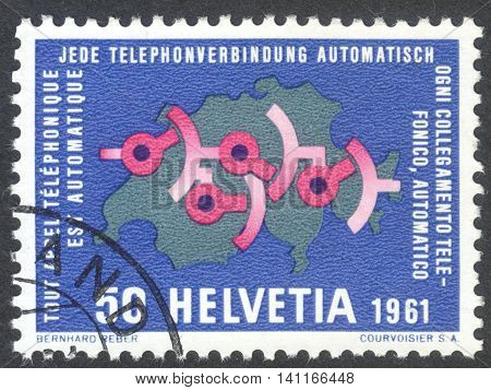 MOSCOW RUSSIA - CIRCA APRIL 2016: a post stamp printed in SWITZERLAND dedicated to fully automatic Swiss telephone service: Wiring diagram on map of Switzerland circa 1961