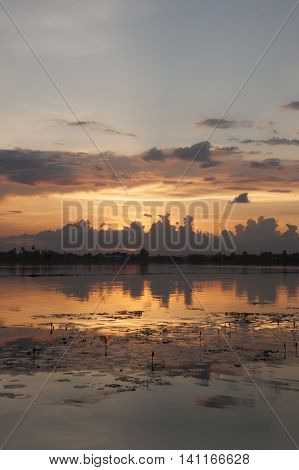 Sunset Reflecting On Large Body Of Fresh Water Asia